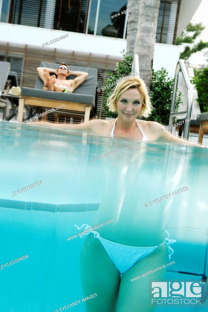 Stock Photo: View of a woman underwater in a swimming pool.
