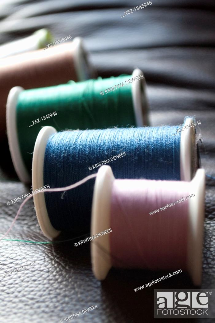 Stock Photo: Several rolls of different colored thread.