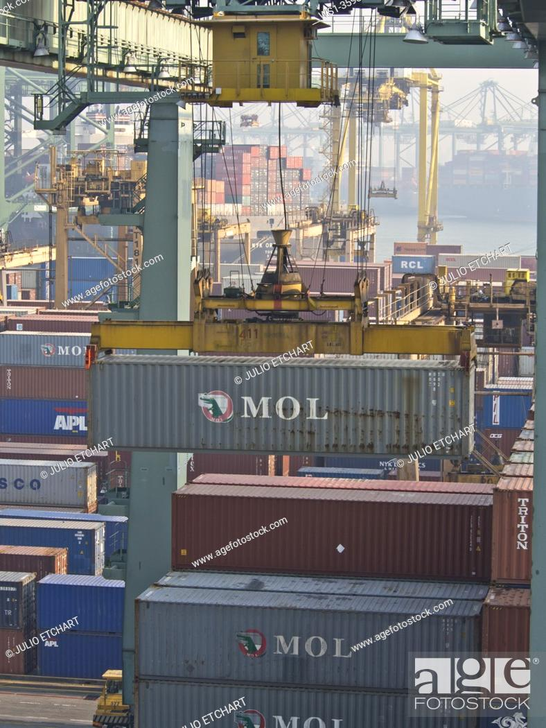 Stock Photo: Port of Singapore container cargo terminal, run by PSA, one of the busiest shipping terminals in the world.