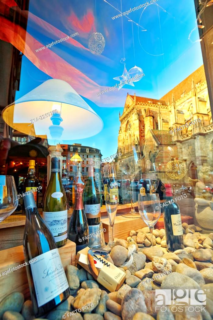 Stock Photo: Wine shop with Saint Martin's church reflection at the city center. Colmar, Haut-Rhin, Alsace, France.