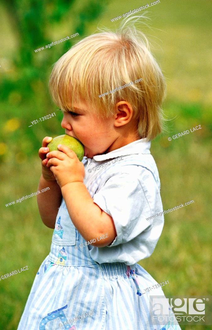 Stock Photo: Girl Eating Apple.