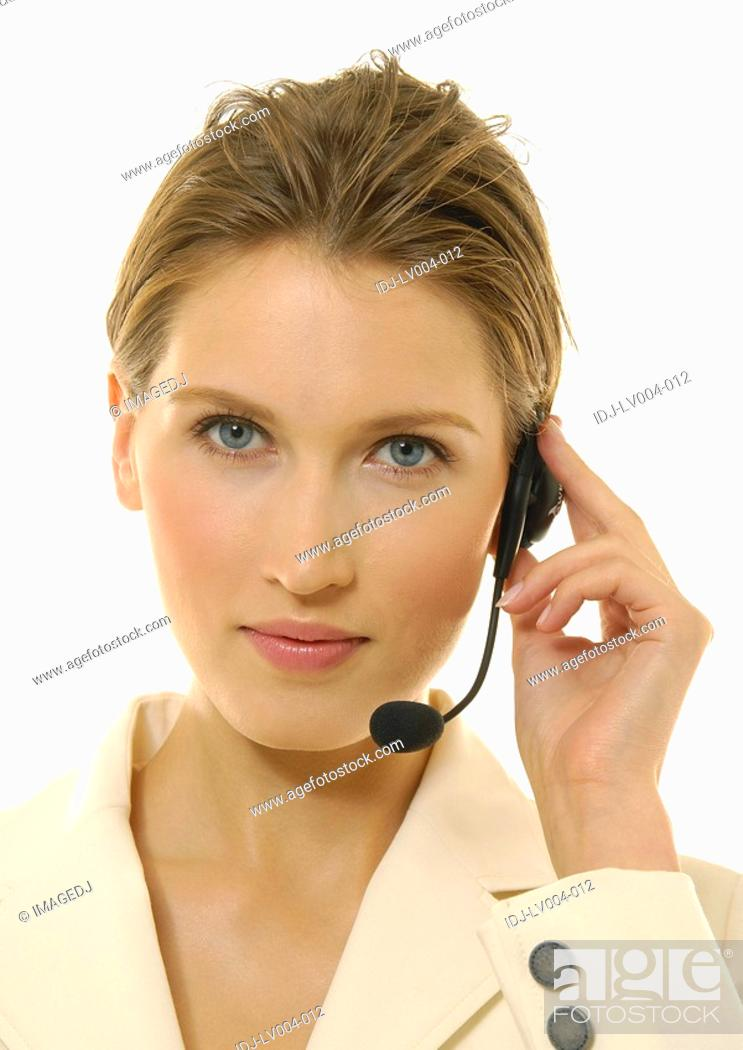 Stock Photo: Portrait of a businesswoman wearing a headset.