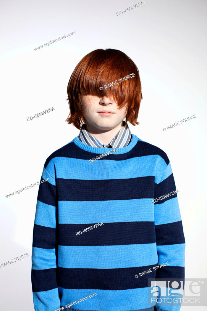 Stock Photo: Boy in striped sweater with hair covering his eyes.