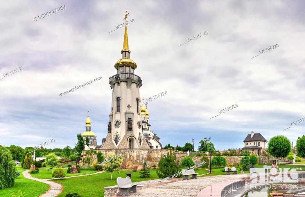 Stock Photo: Buki, Ukraine 06. 20. 2020. Temple Complex with landscape Park in Buki, Ukraine, on a cloudy summer day.