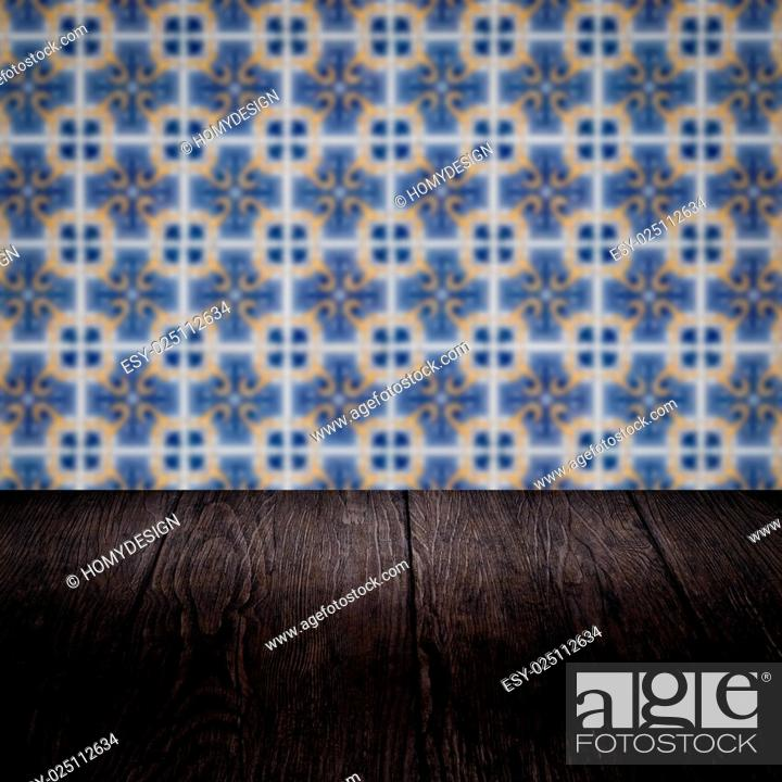 Stock Photo: Empty wood table top and blur vintage ceramic tile pattern wall in background, Mock up template for display of your product.