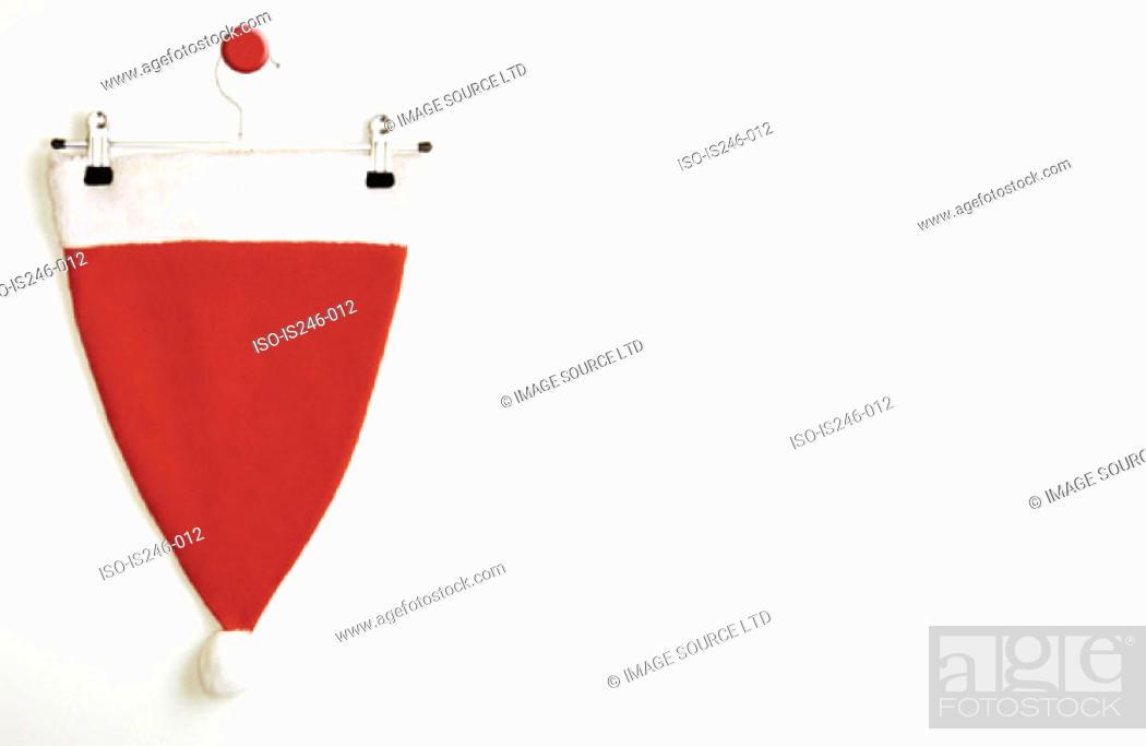 Stock Photo: Bobble hat on hanger.