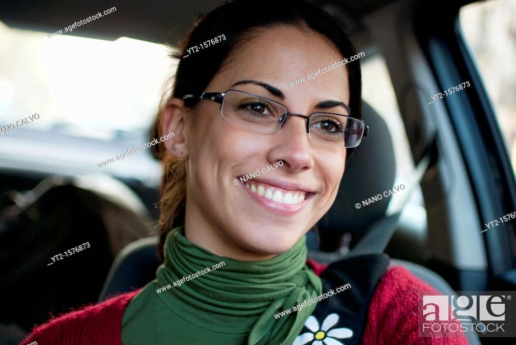 Stock Photo: Attractive young woman drives her car.