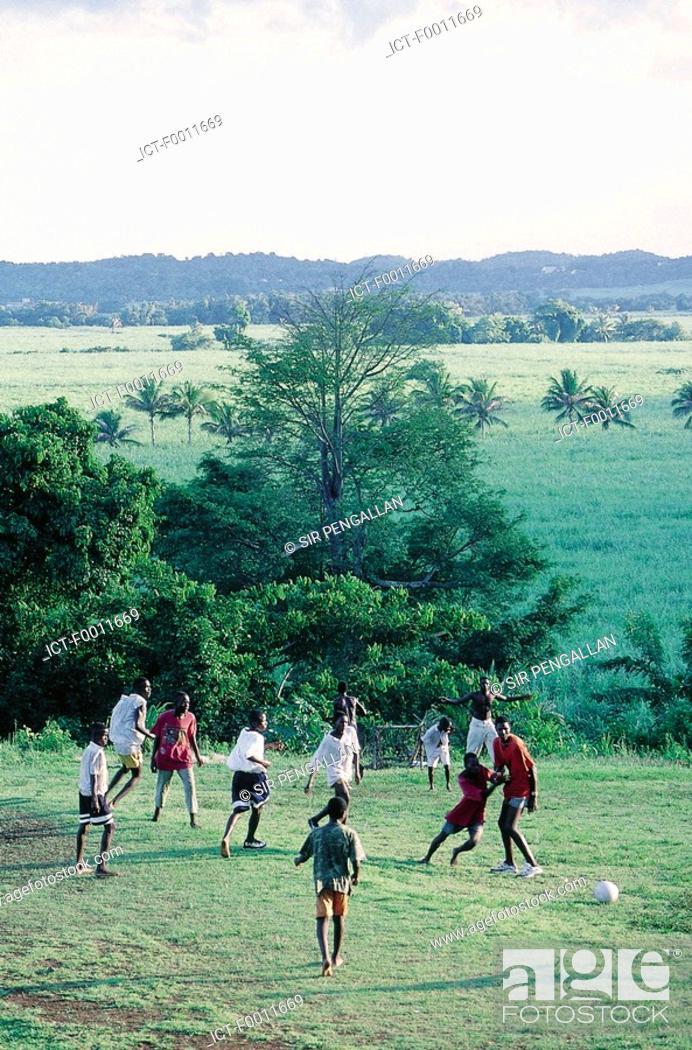 Stock Photo: Jamaica, Golden Grove vicinity, playing rural football.