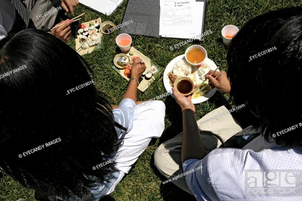 Stock Photo: View of three colleagues having lunch together.