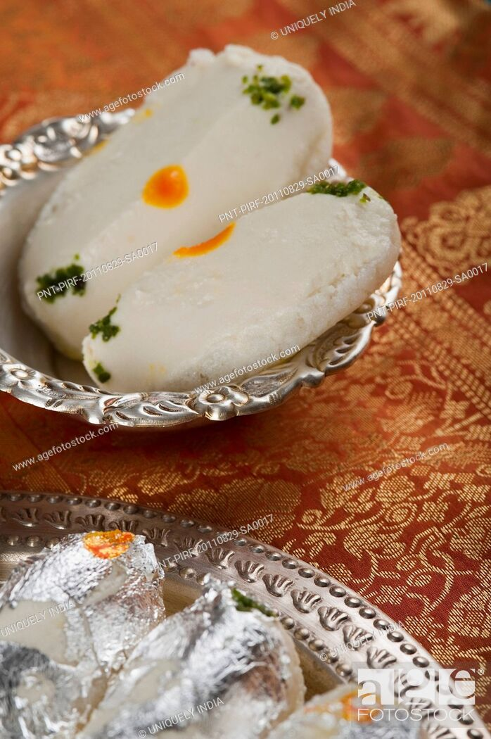 Stock Photo: Close-up of cham cham a traditional Indian sweet made from chhena (cottage cheese) and khoya (solid milk).