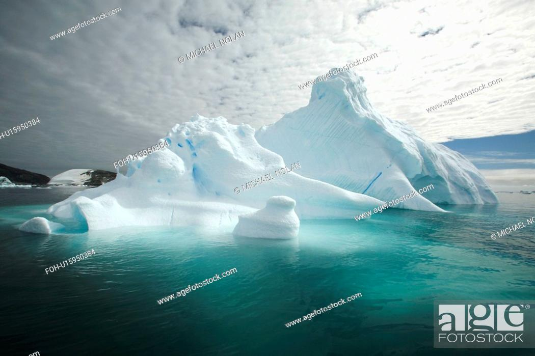 Stock Photo: Strange and wonderful formations in the icebergs and bergy bits in and around the Antarctic Peninsula during the summer months.