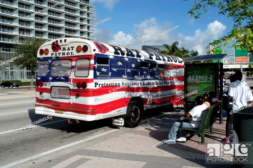 Stock Photo: A bus painted with the American flag in Miami Downtown.