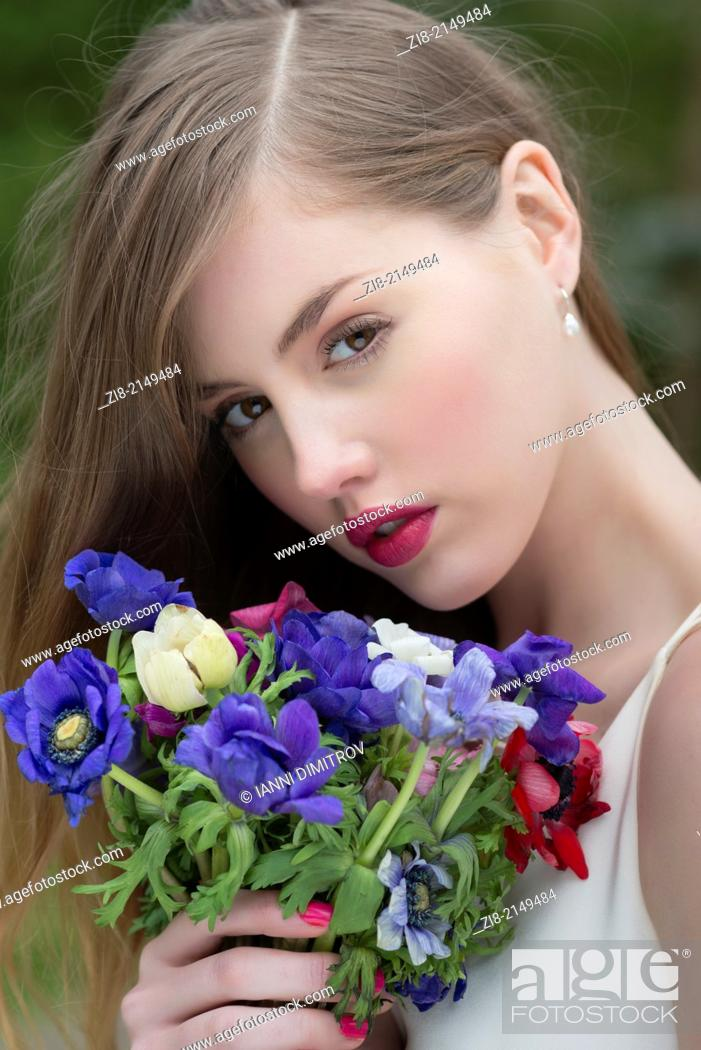 Stock Photo: Girl with wild flowers bouquet.