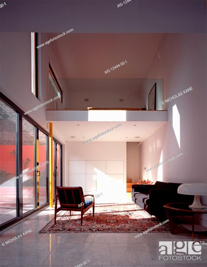 Mezzanine In Double Height Living Room And Wall Of Glass Doors Stock Photo Picture And Rights Managed Image Pic Aig 12444 50 1 Agefotostock