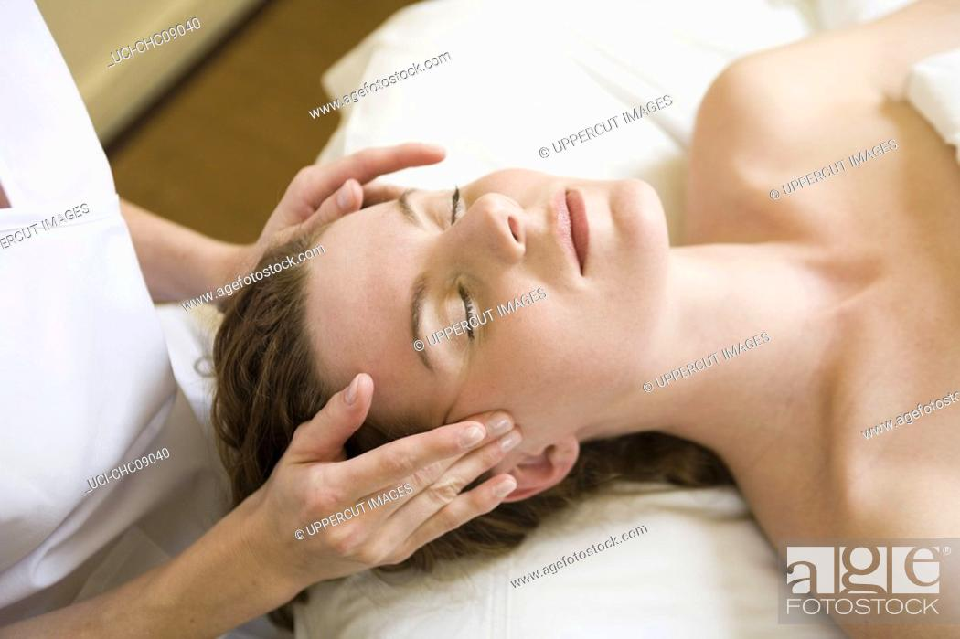 Stock Photo: Woman receiving facial massage.
