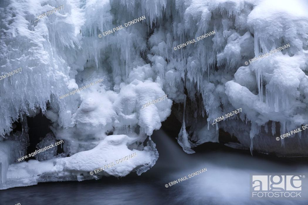 """Stock Photo: The natural feature known as """"""""The Basin"""""""" along the Pemigewasset River in Franconia Notch State Park of Lincoln, New Hampshire during the winter months."""