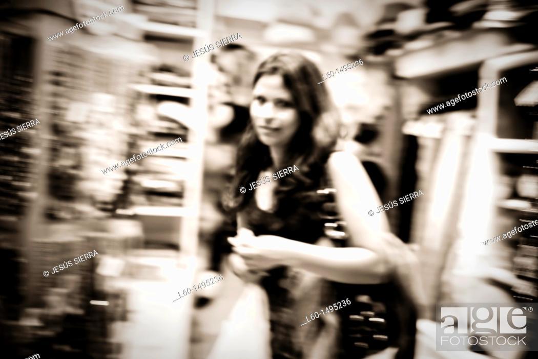 Stock Photo: Girl in shop, Madrid, Spain.