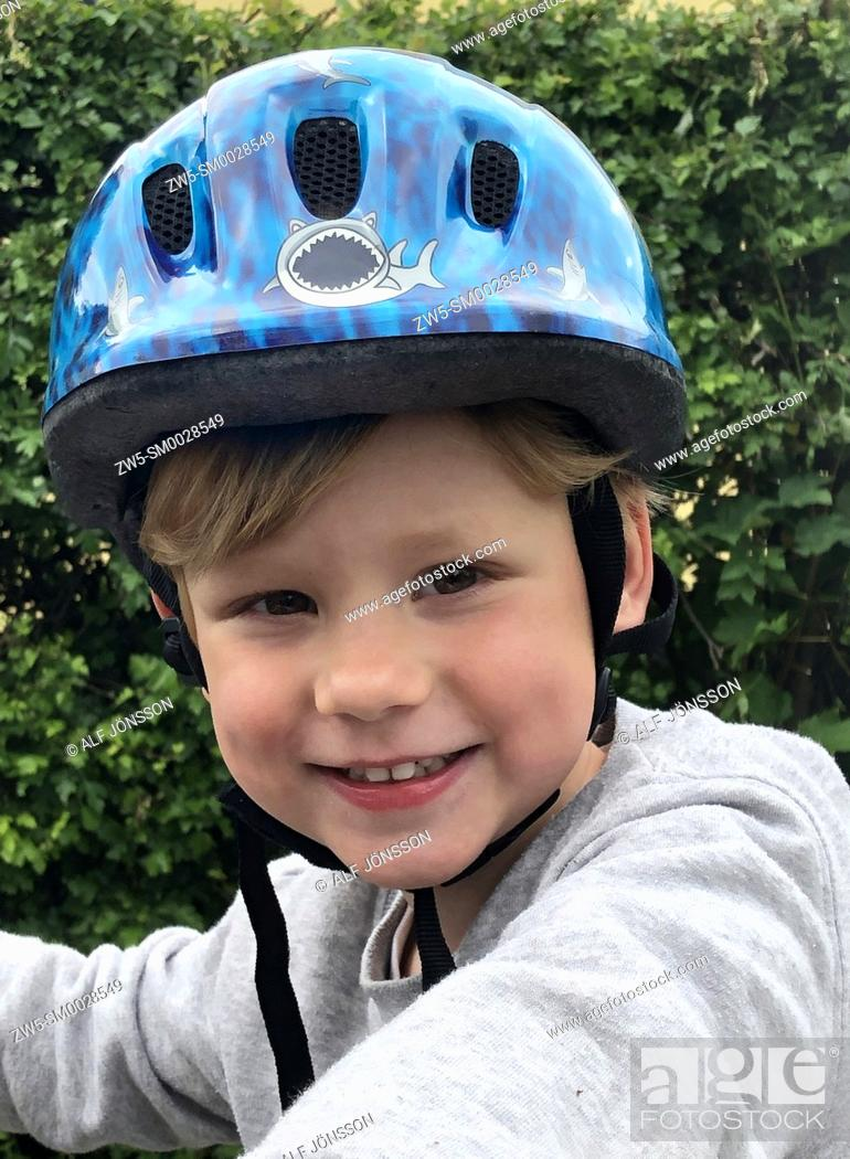 Stock Photo: Portrait on a boy, 4 years old, with a bicycle helmet in Ystad, Scania, Sweden; Scandinavia.