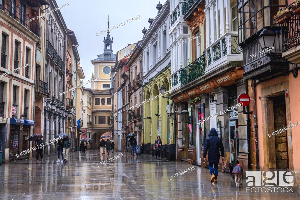 Stock Photo: Buildings on Calle Cimadevilla - a street in Oviedo in Asturias region of Spain, view with tower of City Hall building.