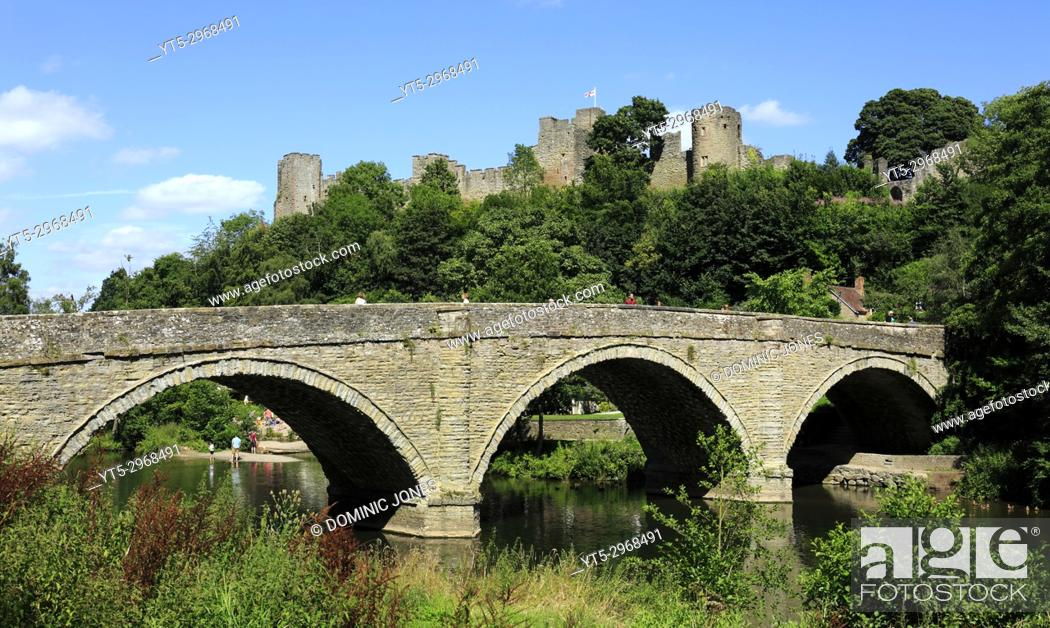 Stock Photo: Dinham bridge crosses the River Teme with Ludlow Castle completes the backdrop, Ludlow, Shropshire, England, Europe.