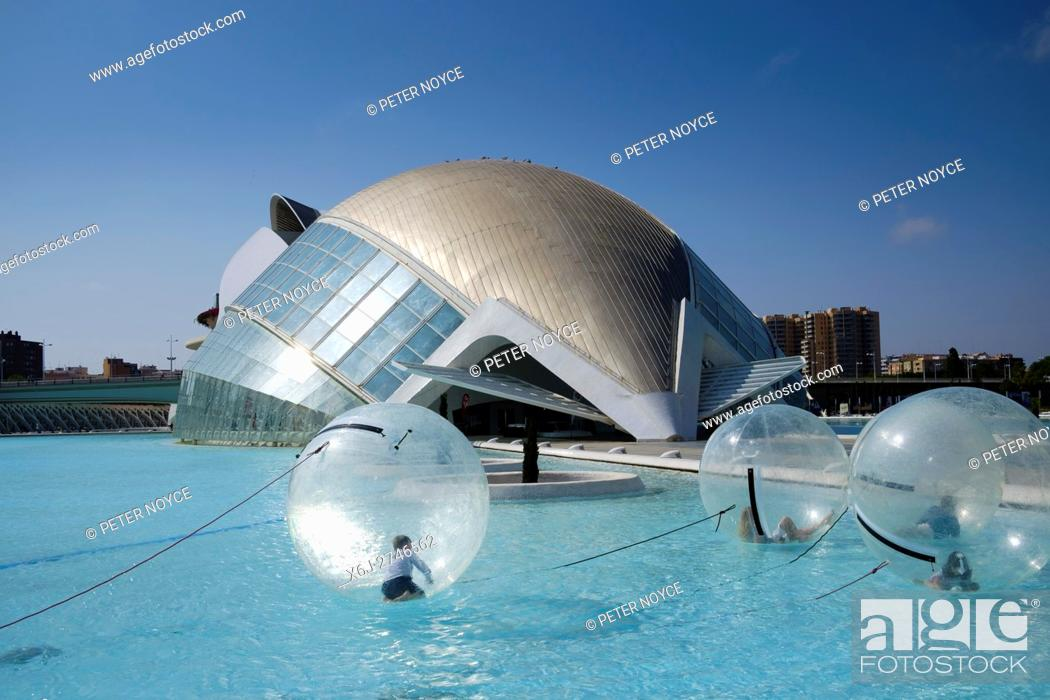 Stock Photo: Children inside a water walking ball at the science park in front of the Hemisferic iMax building at Valencia.