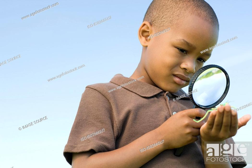 Stock Photo: Boy with a magnifying glass.