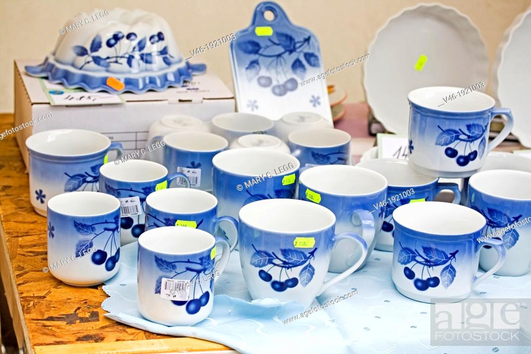 Stock Photo: Ceramics in public market  Tea set of cups and saucers with teapots in stall  Cups have blue cherry pattern  Handcrafted ceramics from local cottage industry.
