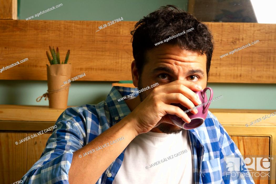 Stock Photo: young man drinking coffee with casual clothes.
