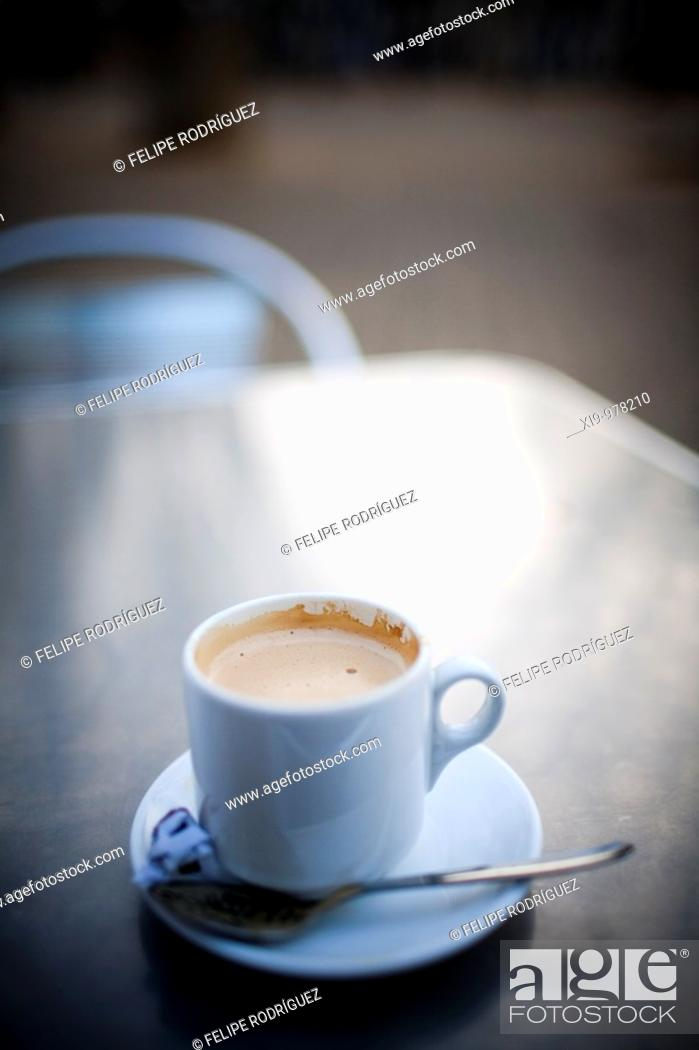 Stock Photo: Cup of coffee on a outdoor table, Seville, Spain.