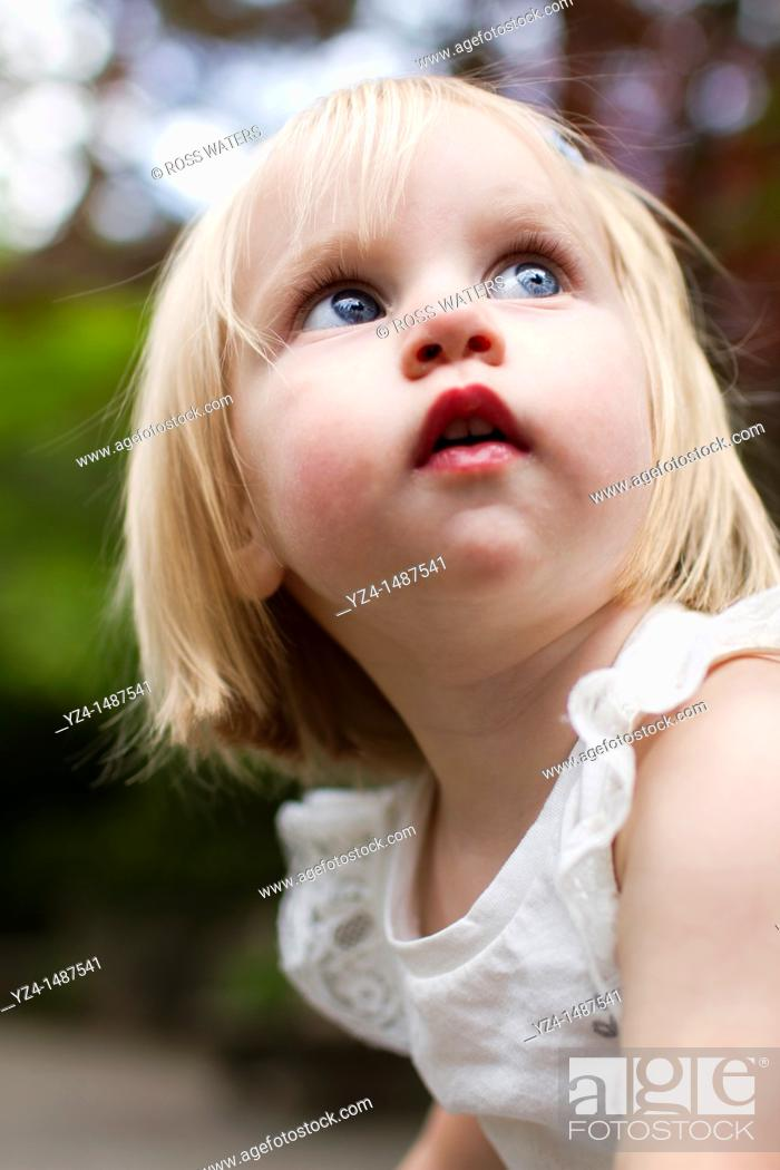 Stock Photo: Female toddler enjoying a day at the park.