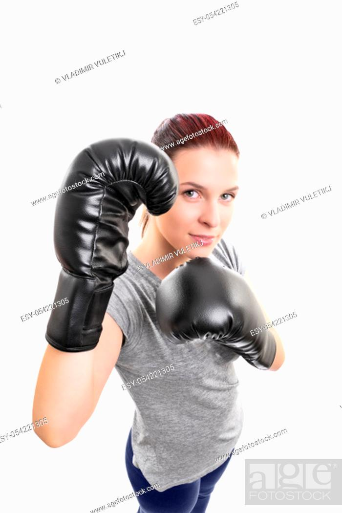 Stock Photo: Top down portrait of a beautiful young woman with boxing gloves in a stance with raised arms looking up, isolated on white background.