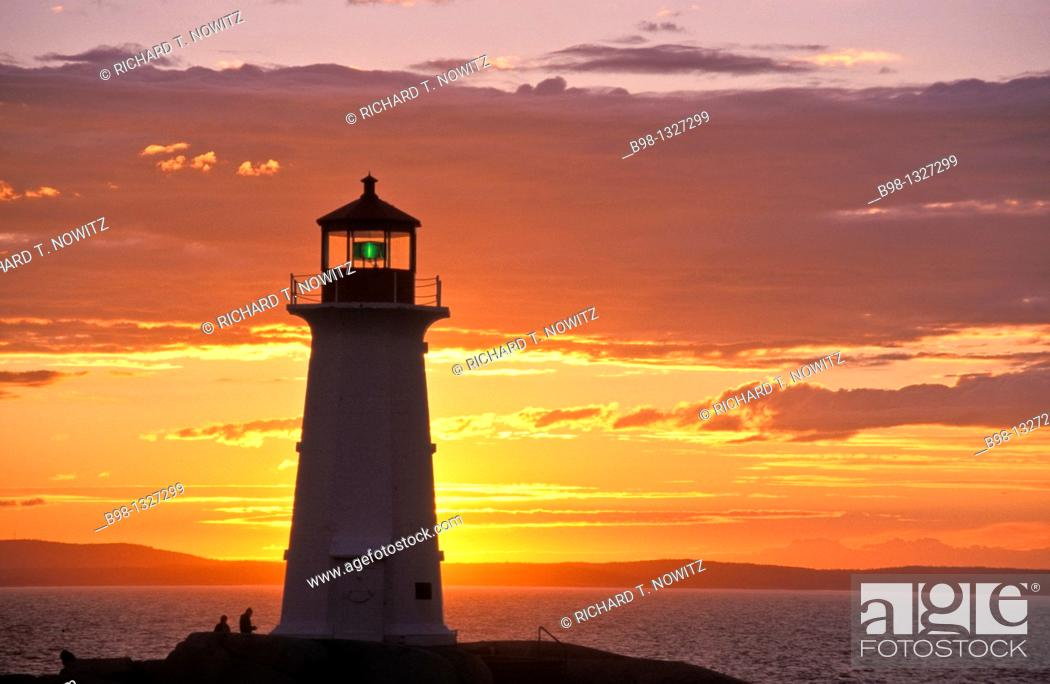 Stock Photo: Lighthouse Silhouetted at Sunset.