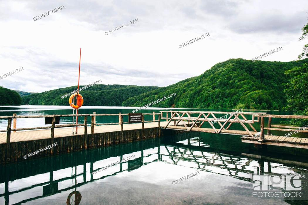 Stock Photo: boat pier beside calm lake at plitvice national park.