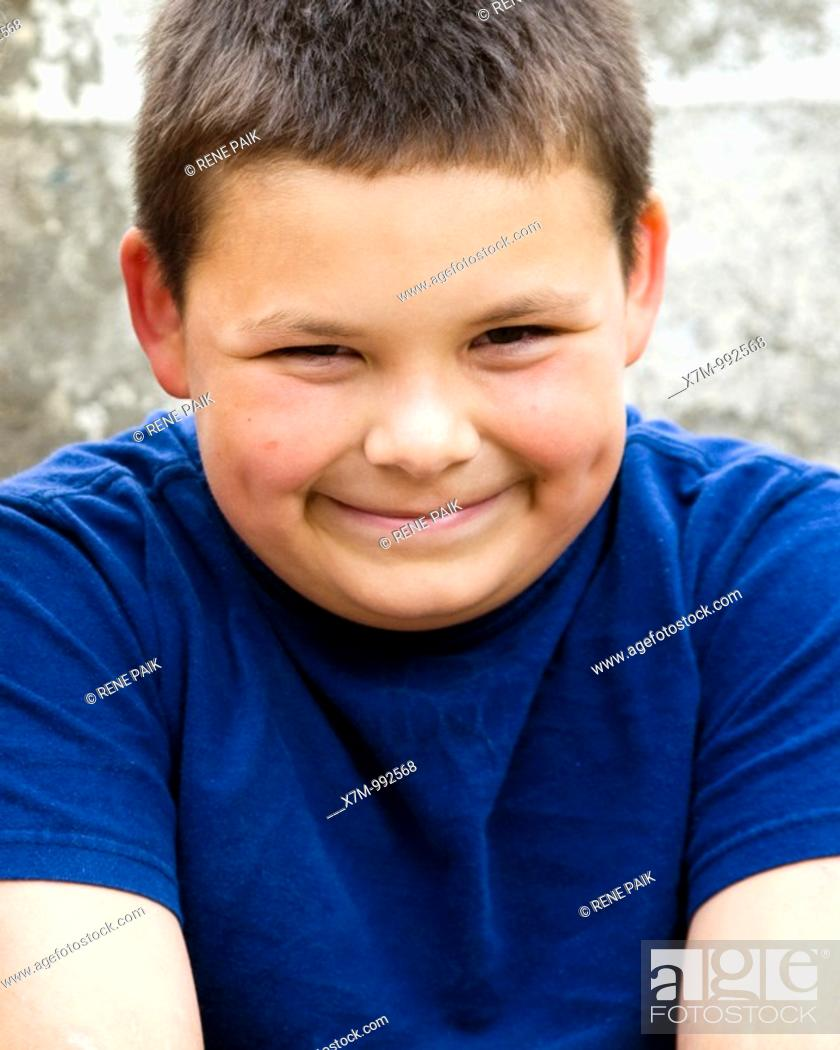 Stock Photo: An hispanic/latin little boy with a nervous smile.
