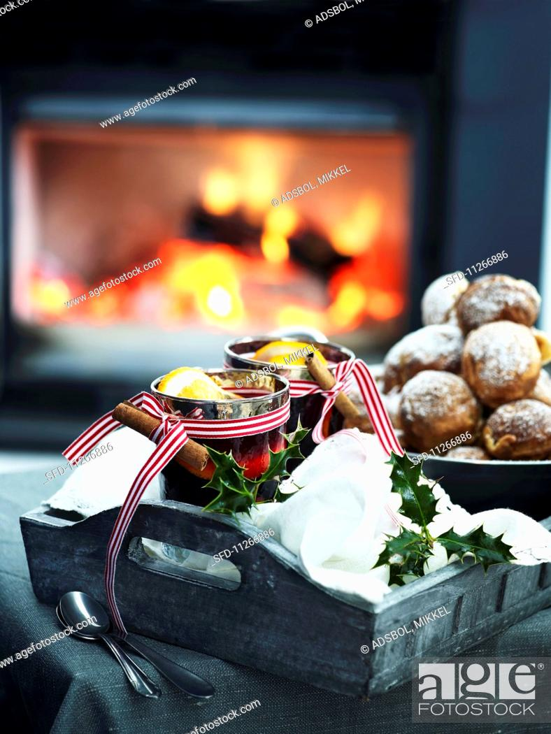 Stock Photo: Mulled wine and Christmas biscuits in front of a fire place.