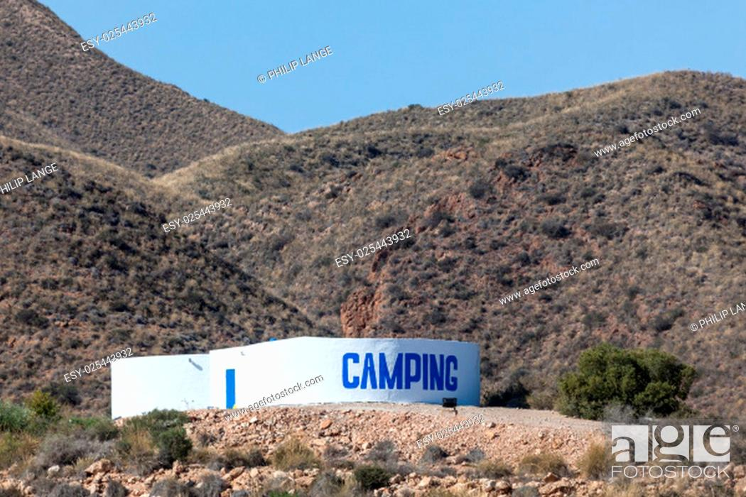 Stock Photo: Camping sign in the mountains.
