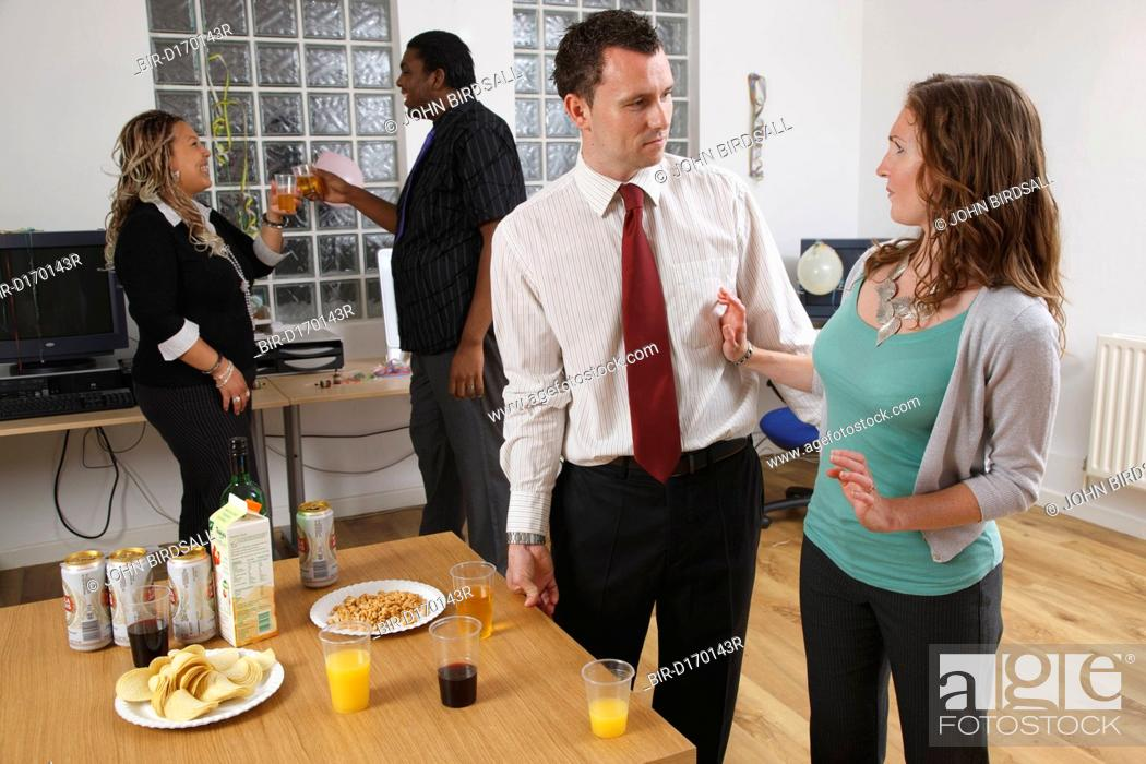 Stock Photo: Woman rejecting unwanted advances from man at party.