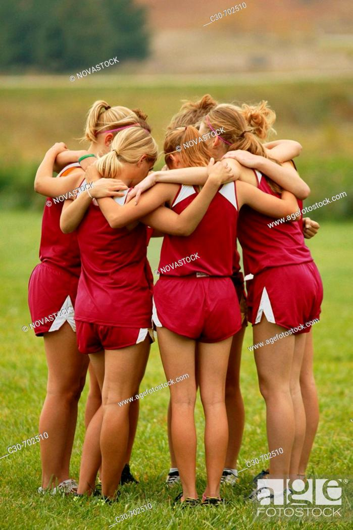 Stock Photo: Teamwork, girls in huddle.