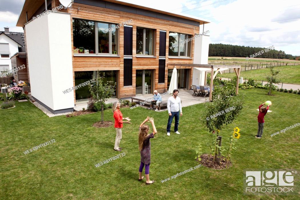 Stock Photo: Germany, Bavaria, Nuremberg, Family playing in garden.