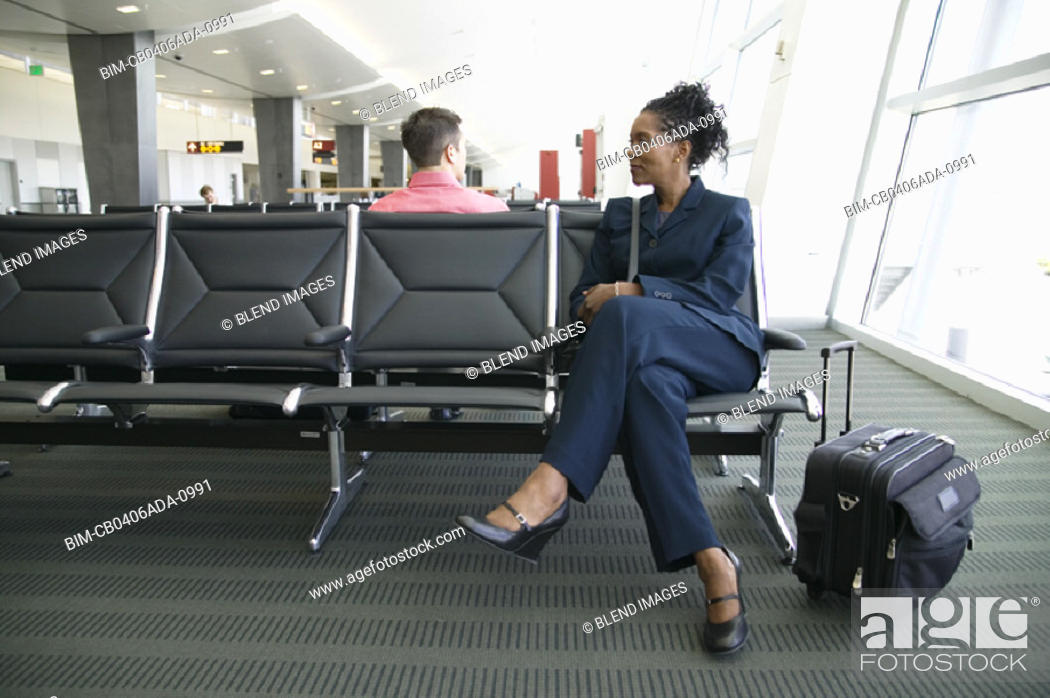 Stock Photo: Woman with suitcase at airport.
