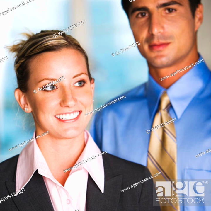 Stock Photo: Close-up of a businessman and a businesswoman.