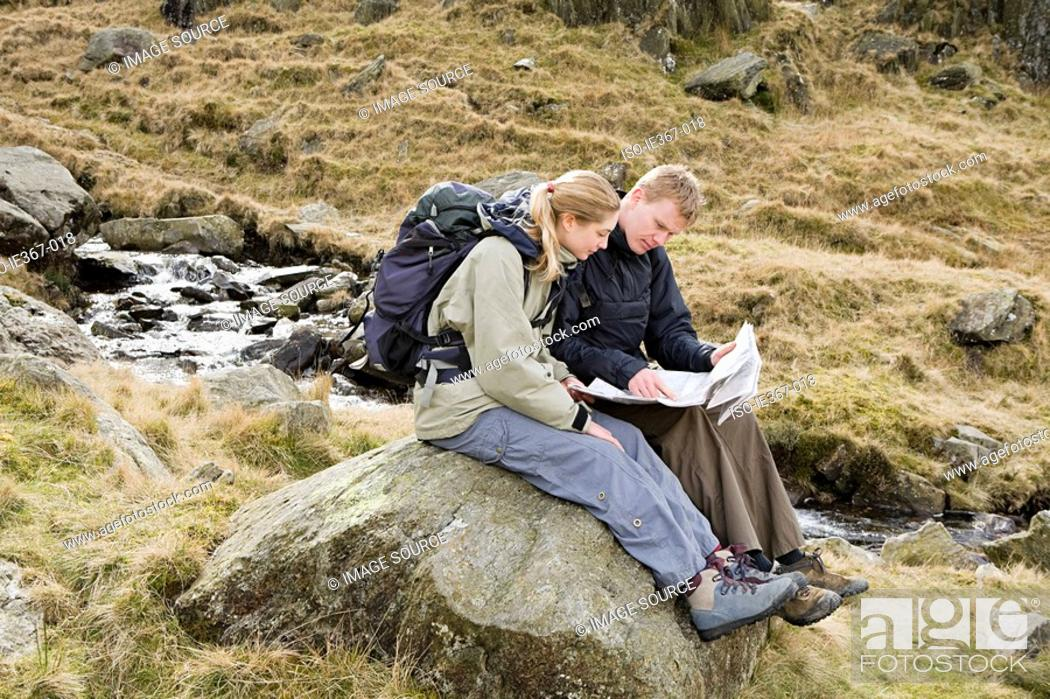 Stock Photo: A couple looking at a map.