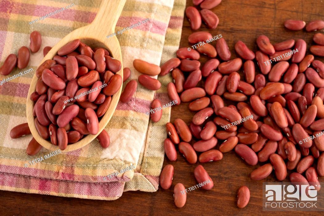 Stock Photo: Kidney beans on wooden spoon.