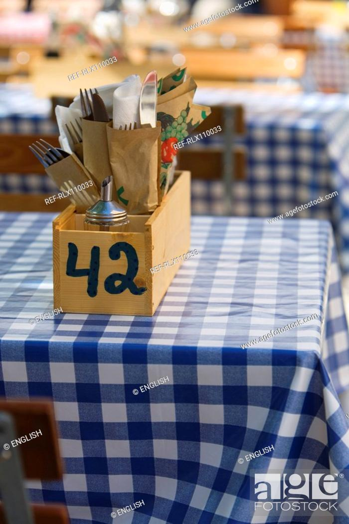 Stock Photo: Cutlery in wooden box on typical German beer garden table, Munich, Germany.