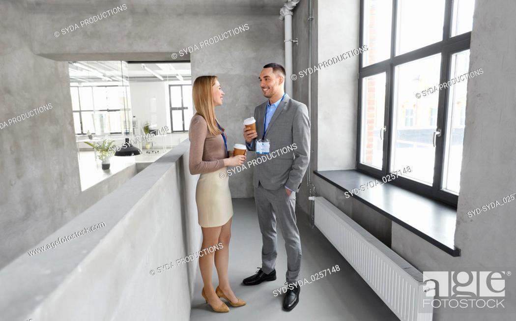 Stock Photo: businesswoman and businessman at coffee break.