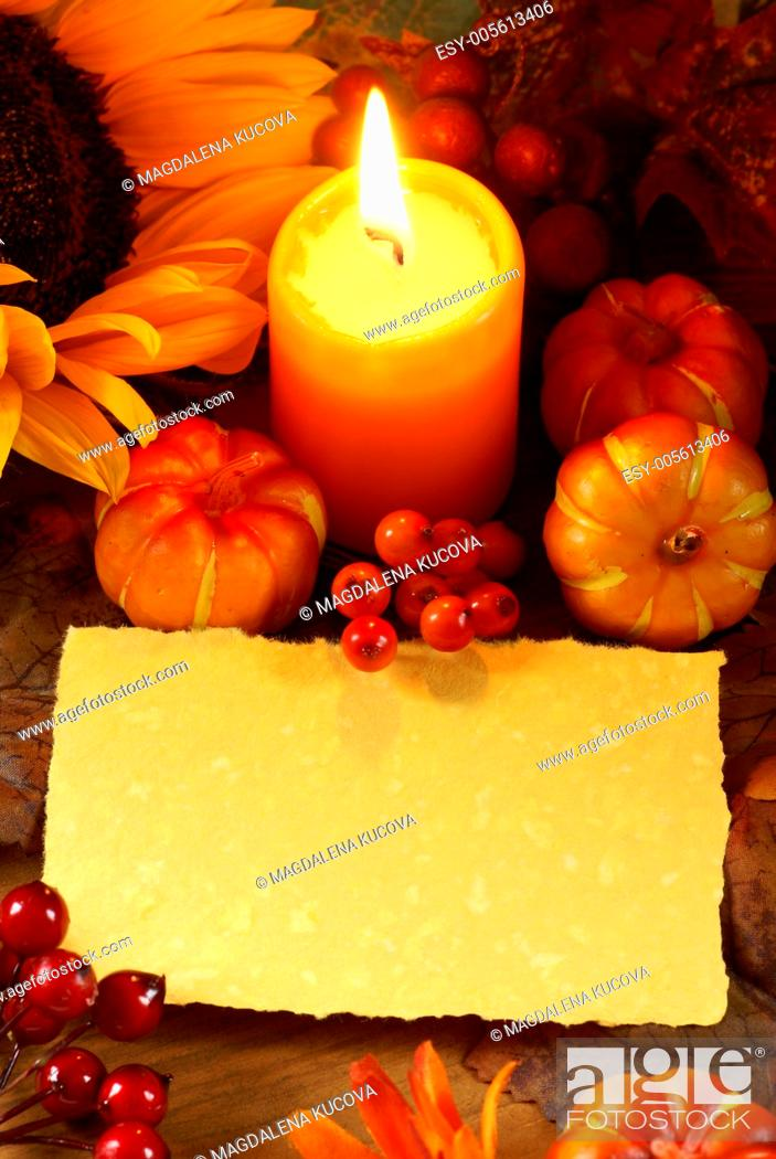 Stock Photo: Arrangement of sunflower, candle and autumn decorations on wooden background with paper copy space.