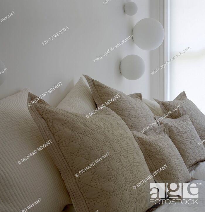 Stock Photo: Assortment of cushions on bed in Greencroft Gardens Apartment, London.