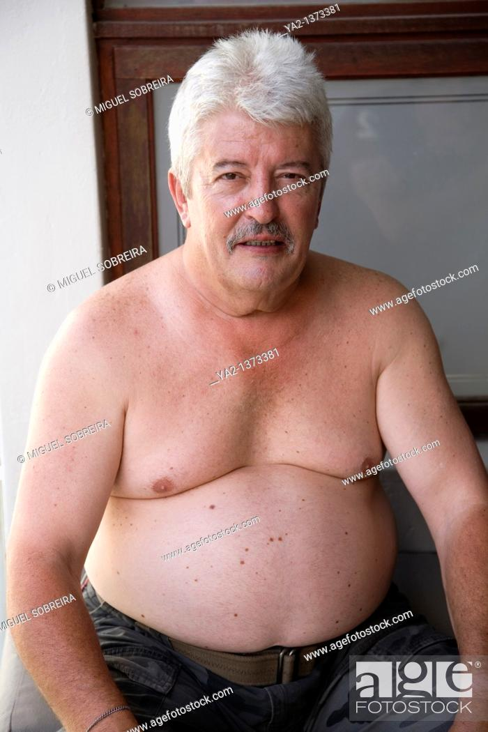 Stock Photo: Overweight male with bare upper torso.