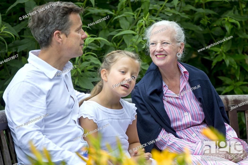 Stock Photo: Danish Queen Margarethe, Crown Prince Frederik and Princess Isabella during a photo session during their summer holidays at Grasten Slot, Denmark, 25 July 2015.