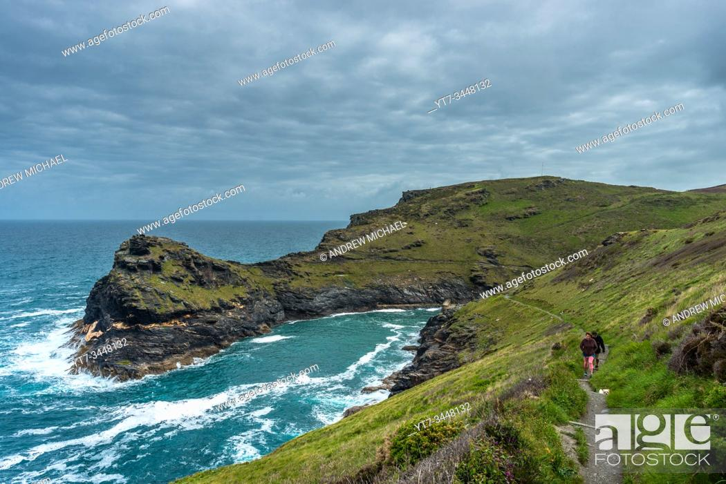 Stock Photo: South West Coast Path with views of Warren point at the entrance of Boscastle Harbour in North Cornwall, England, UK.